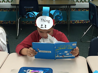 A student deeply engaged in their Dr. Seuss book