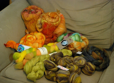 Combospin stashed braids of dyed fibre in oranges and yellows and browns