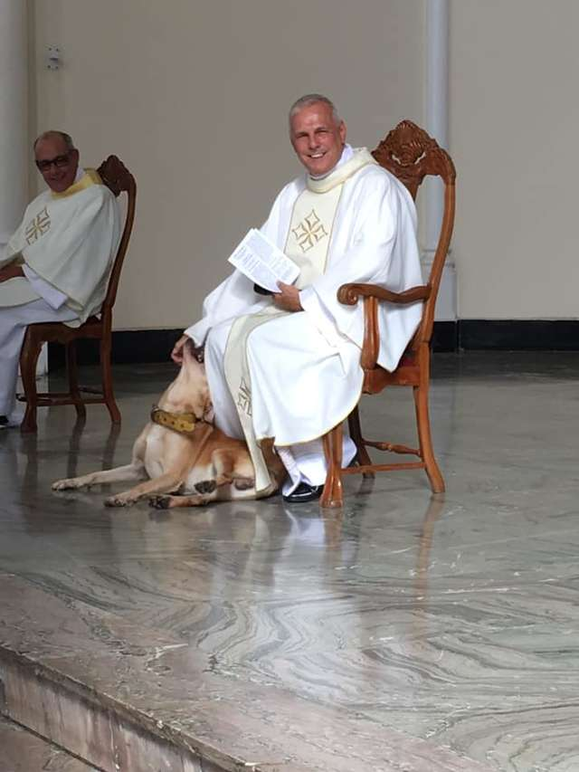 Playful Dog Crashes Church Service And The Priest's Reaction Is Priceless