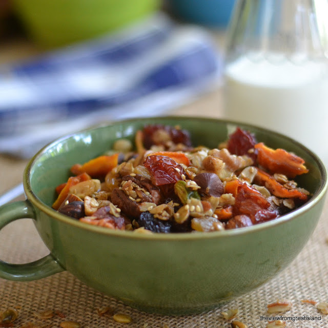 a bowl of fruit and nut granola with milk