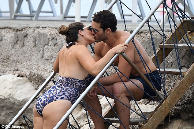 Kelly Brook in bikini goes for a swim in Italy with boyfriend Jeremy Parisi