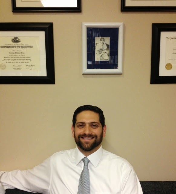 Rabbi Jeremy Fine in his office with a photo of Sandy Koufax