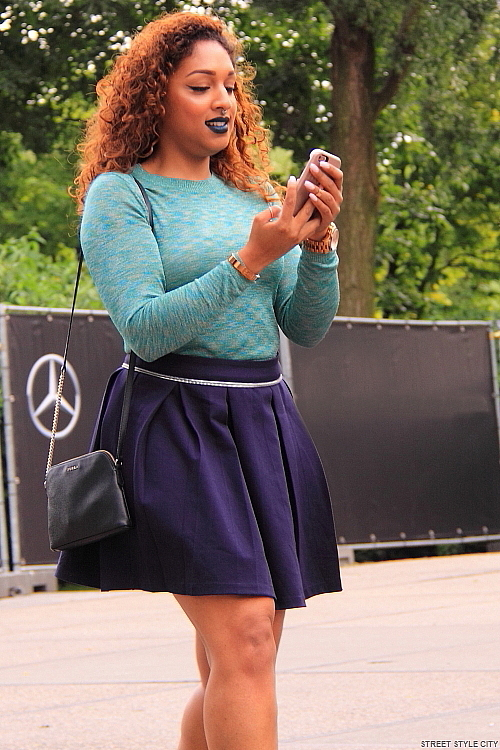Beautiful dutch girl wearing her miniskirt outfit in the street of amsterdam. Trendy streetstyle fashion.