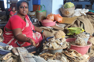 A woman selling dry fishes
