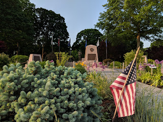 The Franklin Garden Club maintains the flowers beds  around the war memorials on the Town Common