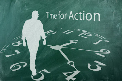 "silhouette of a man walking on the face of a clock entitled ""Time for Action"""