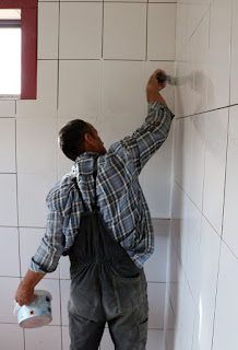 Bekir grouting the bathroom