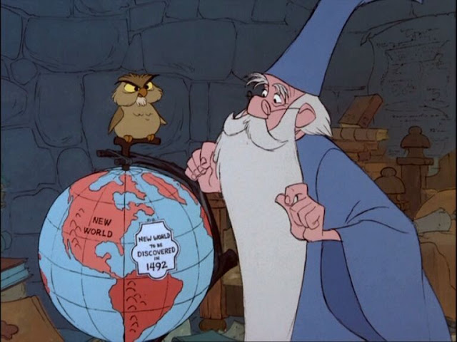 Merlin studies the globe Sword in the Stone animatedfilmreviews.filminspector.com