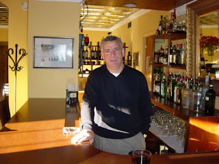 Owner of Osteria 510 behind bar