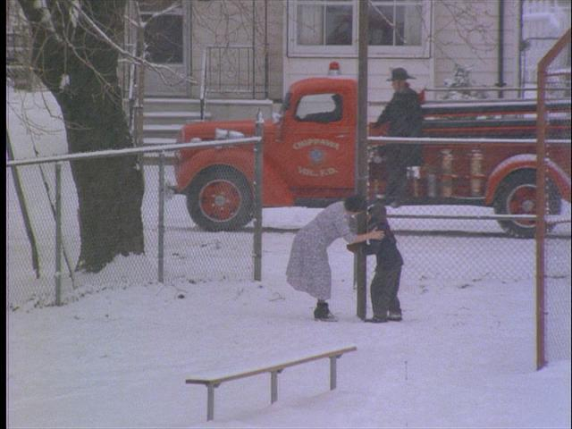 A fire engine coming to rescue Flick in A Christmas Story 1983 movieloversreviews.filminspector.com