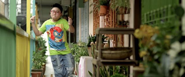 Her rather cute neighbour, Ah Bao (Jayson Tan)