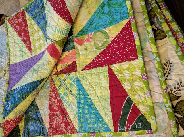 Sawtooth border and feather quilting details
