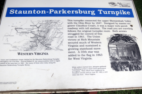 Modern sign describes historic turnpike.