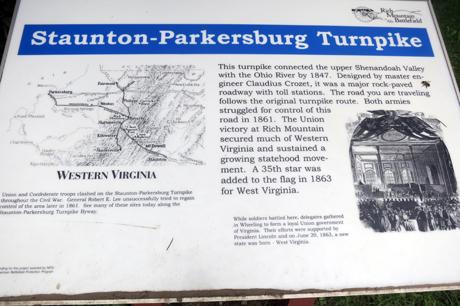 Modern sign describes historic turnpike.