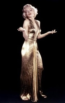 03d528cb74 I adore this stunning golden bronze metallic pleated dress by designer  William Travilla that Marilyn Monroe wore in the film Gentlemen Prefer  Blondes.