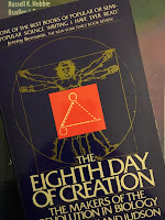 The Eighth Day of Creation: The Makers of the Revolution in Biology, by Horace Freeland Judson, superimposed on Intermediate Physics for Medicine and Biology.