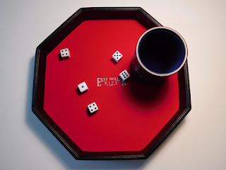 Red dice tray and blue dice cup