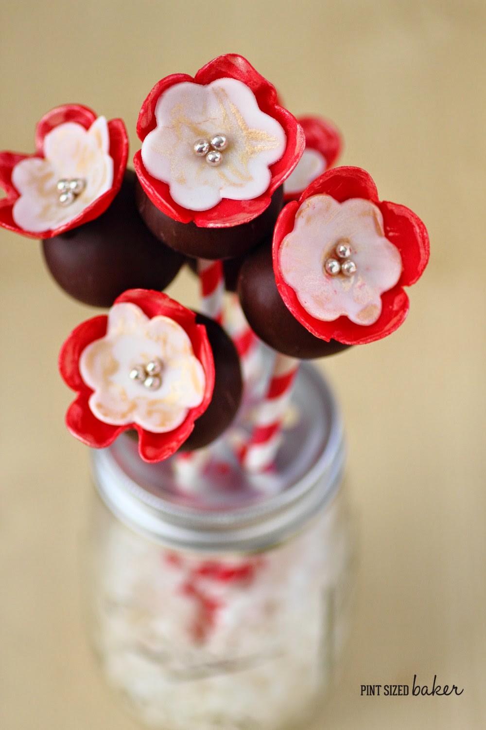 This bouquet of pretty fondant flowered cake pops would be a great gift for my someone special.