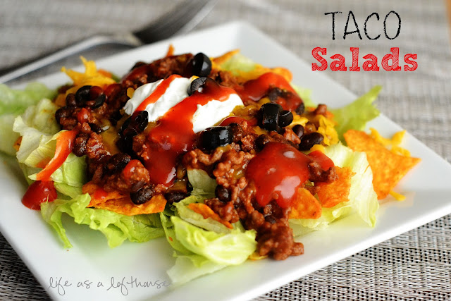 Taco Salads are a bed of iceburg lettuce, crunchy nacho cheese Doritos, and taco meat that is topped off with all your favorite taco toppings. Life-in-the-Lofthouse.com