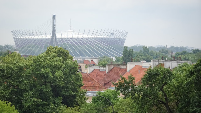 The soccer statium is visible from the old town, even though it is far away.