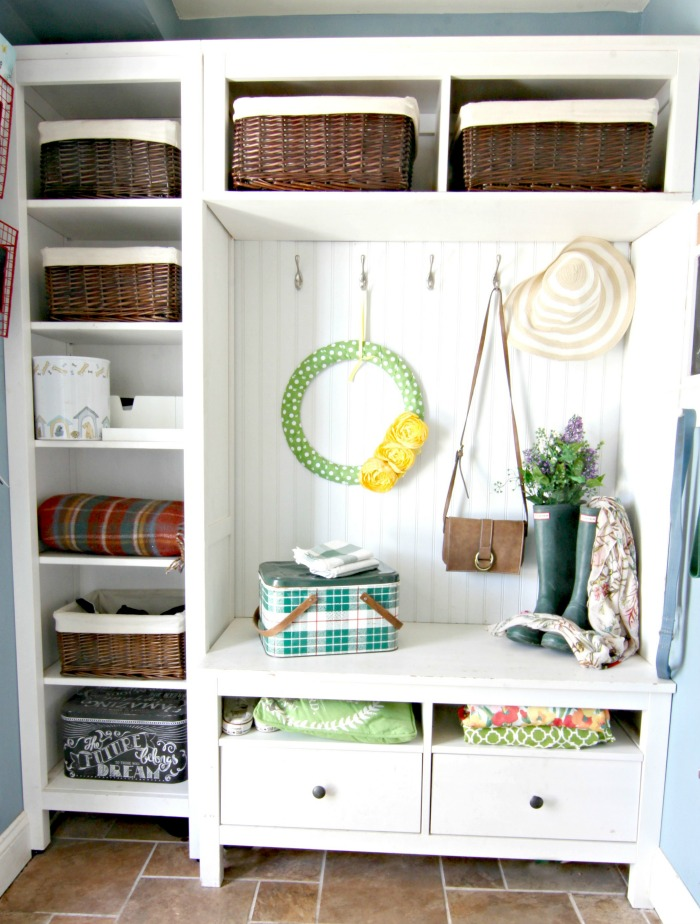 DIY Ikea hack mudroom using Hemnes bookcases in mudroom with spring decor - www.goldenboysandme.com