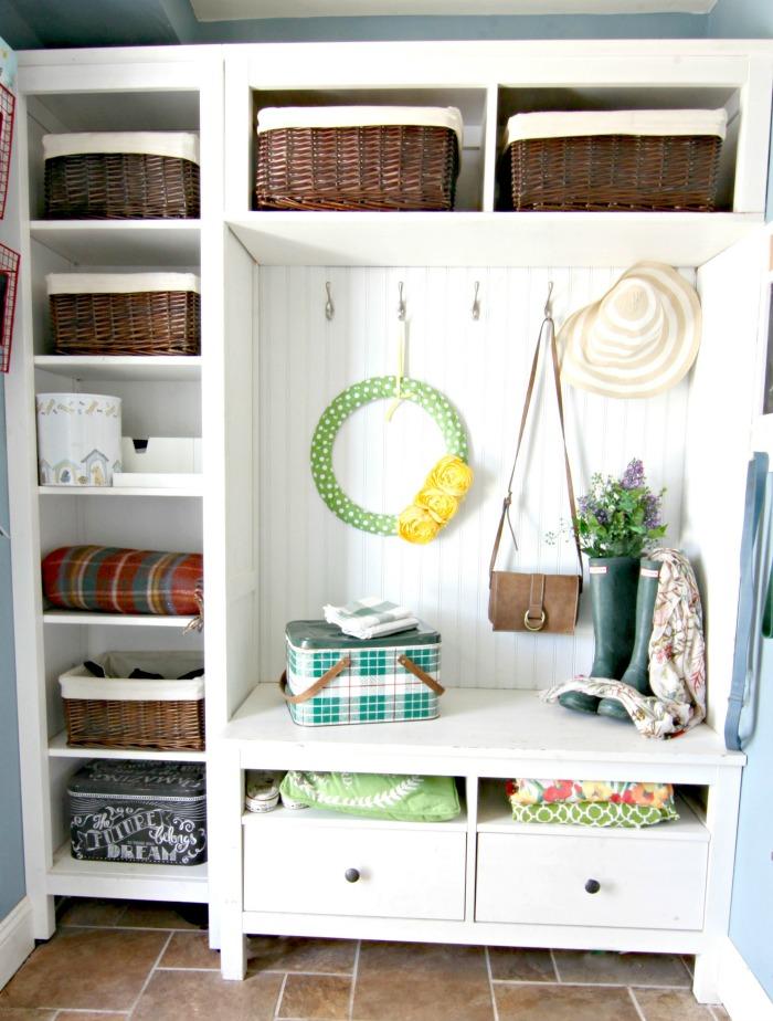 DIY Ikea hack mudroom using Hemnes bookcases in mudroom with spring decor - www.goldenboysandme.com