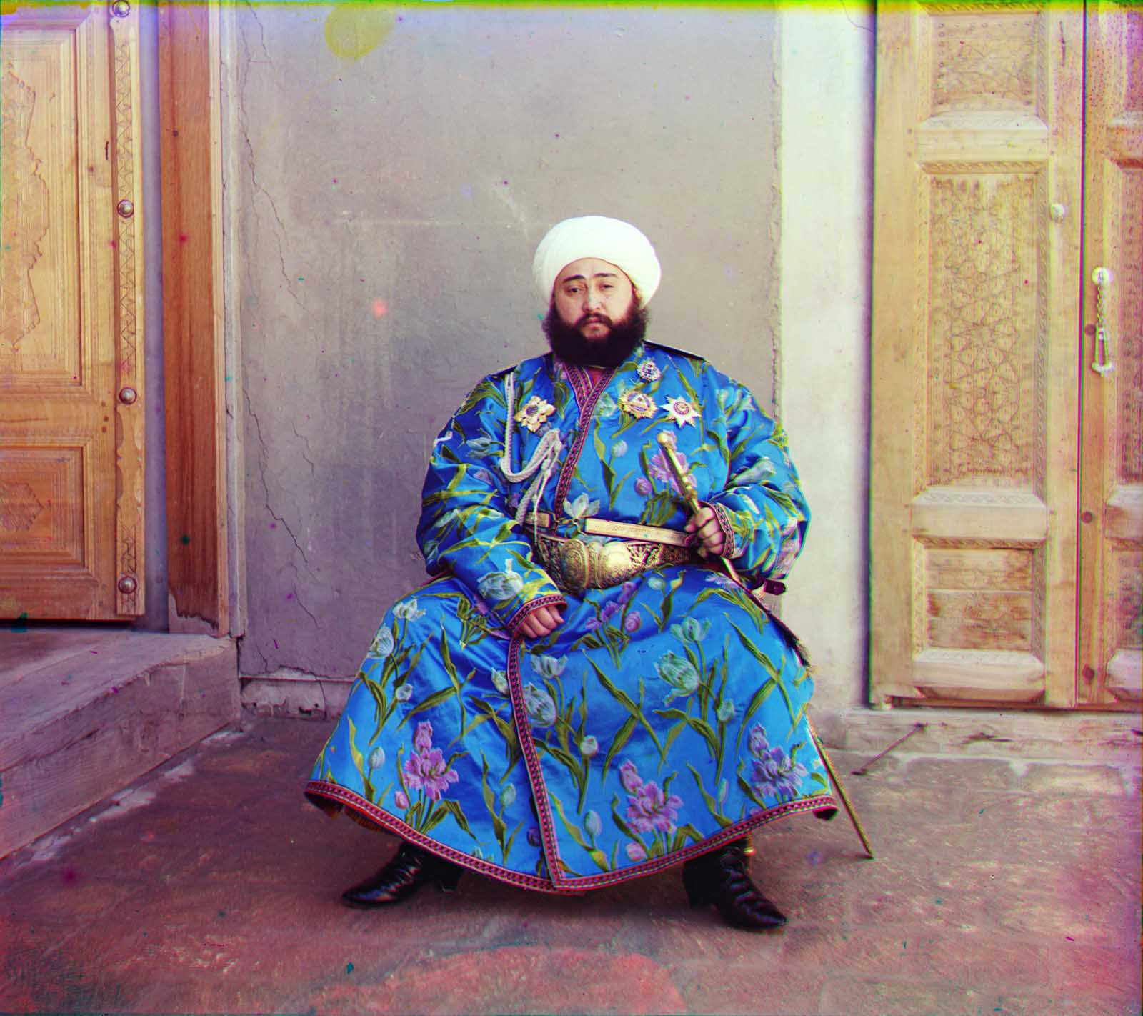 Emir Seyyid Mir Mohammed Alim Khan, the Emir of Bukhara, seated holding a sword in Bukhara, (present-day Uzbekistan), ca. 1910.