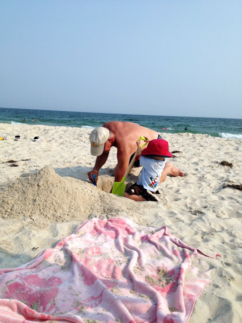 grandpa digging hole for baby