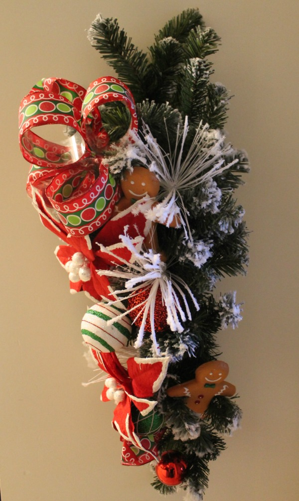 Boys snowy branches a christmas ribbon and some christmas ornaments