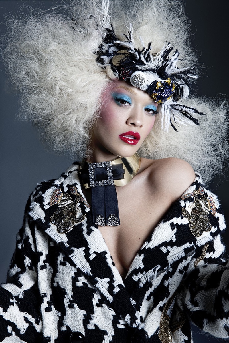 Rita Ora poses in Dolce & Gabbana coat, necklace and headpiece
