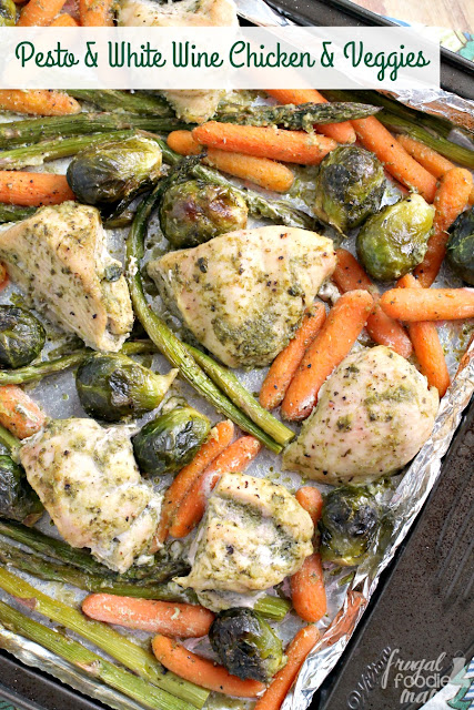 This flavorful & easy to make Pesto & White Wine Chicken & Veggies will quickly become your new go-to sheet pan dinner recipe.