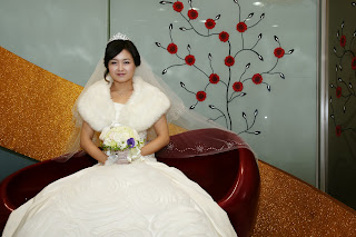 Korean bride before the wedding ceremony having photos