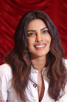 Priyanka Chopra in White Shirt and Colorful Skirt at Baywatch Press Conference  15th May 2017 ~  Exclusive 32.jpg