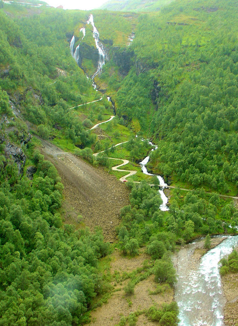 The 21 sinuous bends of Rallarvegen Road winding its way back up Myrdal Mountain.