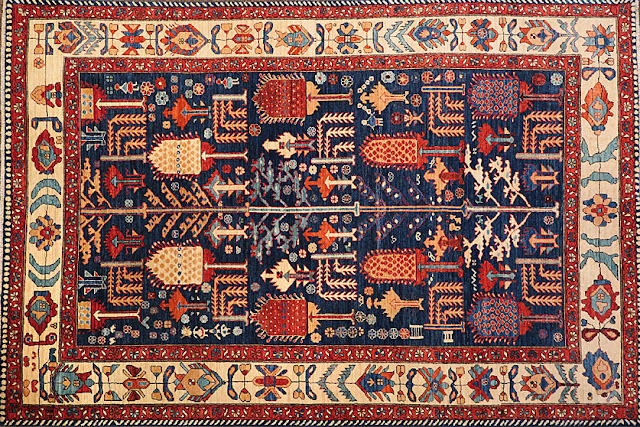 A colorful Bakhtiari rug with floral motifs.