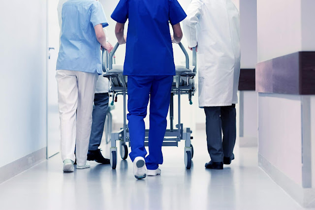 Nurses walking through hospital hallway