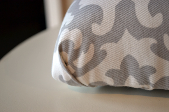 Corner of cushion with gray and white fabric
