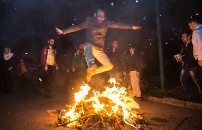 Iranian festival of fire and light is held the last Wednesday night before the Persian New Year. It includes people going to the streets and making bonfires and jumping over them while wishing felicity and healthiness in the New Year.