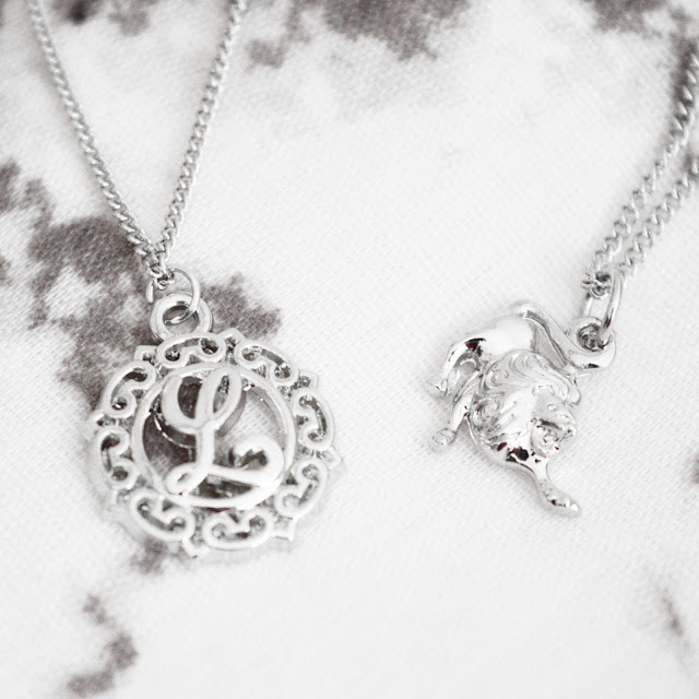 Silver boho necklaces, one lion for leo and one L initial necklace.