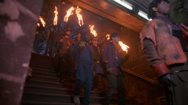 The gang heads underground while carrying torches