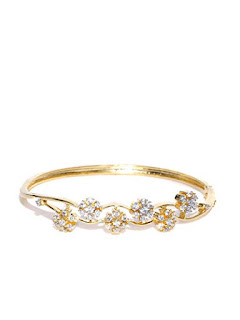 https://www.amazon.in/gp/search/ref=as_li_qf_sp_sr_il_tl?ie=UTF8&tag=fashion066e-21&keywords=Pearl Bangles&index=aps&camp=3638&creative=24630&linkCode=xm2&linkId=36220247e21ade04d71ed2d1d95c146a