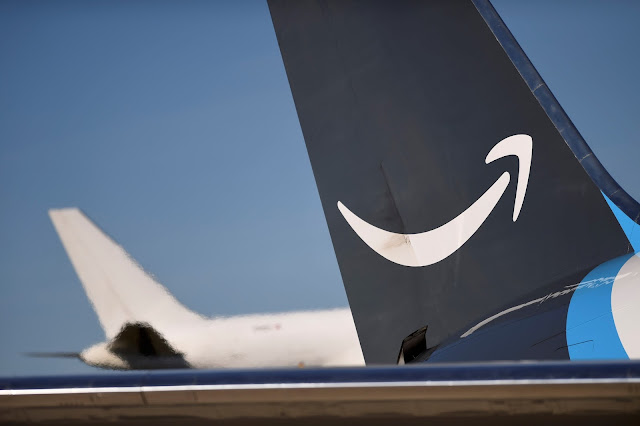 Image Attribute: A wide body aircraft emblazoned with Amazon's Prime logo is unloaded at Lehigh Valley International Airport in Allentown, Pennsylvania, U.S. December 20, 2016. Picture taken December 20, 2016.   REUTERS/Mark Makela