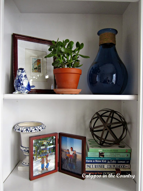 Bookshelf styling  in blue and white home office