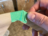 Adding tape to the corner to keep the glue from sticking to the corner