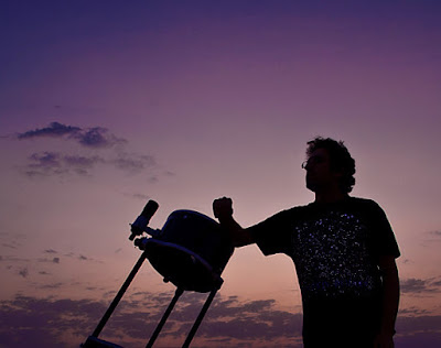 Amateur Astronomer with his Backyard Telescope