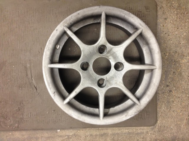 Chemically stripped Caterham R500 8 spoke wheel.