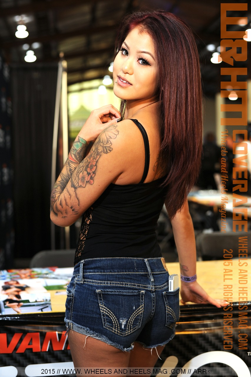 Drea Lynn in black top and denim shorts in 2015 Hot Import Nights San Diego