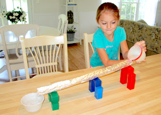 Tessa greatly enjoyed this simple project. She tested her Roman aqueduct many times.