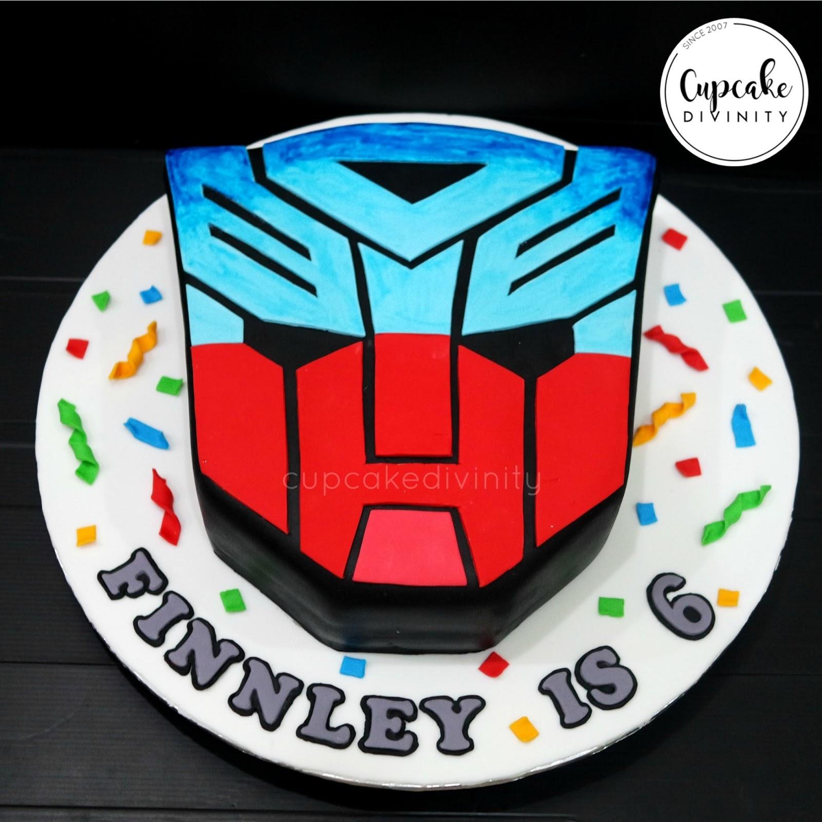 Cupcake Divinity Transformers Logo Cake