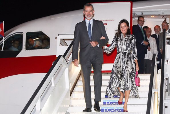 Queen Letizia wore Hugo Boss Danimala Belted midi shirt dress in zebra-print Italian twill. Letizia carried Uterque bag in pink